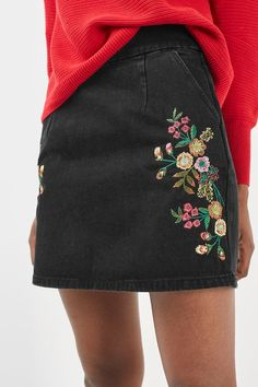 The embroidery trend isn't leaving just yet – we love this washed black denim skirt in an a-line fit, featuring intricate floral embroidery. Wear casually with a jumper and trainers. #Topshop