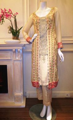Shirt: Fabric: Fine Chiffon Shirt with embroidered front & sleeves and neckline. Shalwar/Trousers: Fabric: Silk. Dupatta: Fabric: Chiffon.