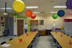 Use paper lanterns for color tables art classroom decor, art classroom management, classroom layout Art Classroom Decor, Art Classroom Management, Kindergarten Classroom Decor, Classroom Design, Classroom Organization, Art Classroom Layout, Classroom Ceiling, Classroom Ideas, Class Management