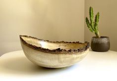 Feature wooden bowl with a beautiful natural edge turned from a beautiful piece of Pistachio timber.