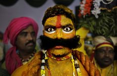 An artist from the state of Telangana reacts to the camera as they wait for their turn to perform during a media preview displaying a glimpse of culture of different parts of India, in New Delhi, India, on, January 22. The tableaux will be part of the Indian Republic Day parade on January 26.