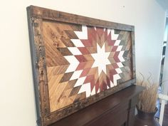 This is a handmade wooden wall mosaic made from upcycled wood. Each piece is hand cut and arranged into this beautiful sunburst to be enjoyed for many years to come. We can do this as a wall piece, table top (with hairpin legs as shown in the last picture), or headboard. Message us for details regarding pricing for tables and and headboards. Dimensions: approximately 42 x 20 or 48 x 24 for best results We do offer frame upgrades. Please message us if you are interested in that option. Our…