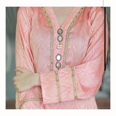 All your Eid wardrobe needs is this vibrant Kurta beautifully crafted with antique mirror embellishments. Neck Designs For Suits, Dress Neck Designs, Sleeve Designs, Blouse Designs, Fancy Dress Design, Stylish Dress Designs, Kurti Embroidery Design, Embroidery Neck Designs, Mirror Work Kurti Design