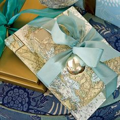"What a great wrapping idea.  In the States thin maps like these are fairly inexpensive and it's a good way to be intentional with the meaning of Christmas...""For God so loved the world that He sent His only Son..."""