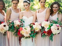 The bouquets are just as beautiful as the bride and her bridesmaids! (Photographer: @LindseyOcker)