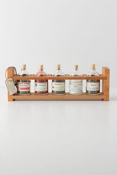 Apothecary Spice Rack  #anthropologie -- make cute labels and put them on glass bottles