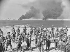 Allies and Australian Forces first took the Libyan city of Tobruk during Operation Compass, which captured several cities across Libya and Egypt from December 9th 1940 - February 9th 1941. This photo shows members of the Australian 2/11th Infantry Battalion after attacking anti-aircraft guns on January 22, 1941. Tobruk fell to Allied forces later that day. https://cas.awm.gov.au/item/005392