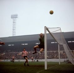 Southampton goalkeeper Eric Martin swings on the crossbar as the ball flies over the bar during a game against Sheffield Wednesday at Hillsbrough, 1969 Vintage Tv, Vintage Photos, Pat Jennings, Chris Wright, West Ham United Fc, Basketball Court, Soccer, Sheffield Wednesday, Sheffield United