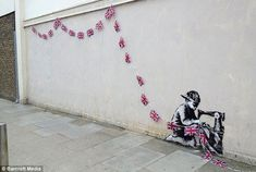 A new piece of stencilled graffiti, possibly by Banksy, has appeared on the wall of a Poundland shop in Haringey, north London
