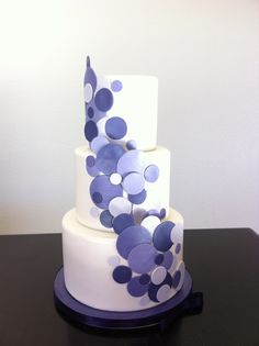 Whimsical purple circle cutouts themed from their wedding invitation www.gimmesomesugarLV.com