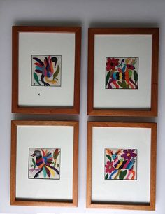Otomi embroidered image in cotton. 9x6.5 inches. Frame in wood and frame in steel. Steel frame 12.5x 12.5 inches. Wooden frame varies. All pieces are different. Please select color (multicolor, grey, blues, black, white, reds, pink, greens) and also the animals (birds, deers, fishes,