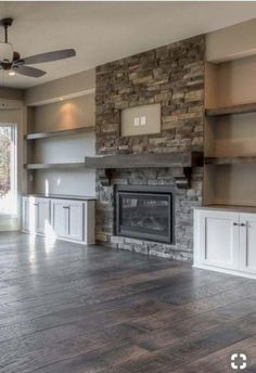 I really like this stackstone fireplace with the built in cabinets on either sid. - I really like this stackstone fireplace with the built in cabinets on either side and the shelf's - Fireplace Built Ins, Farmhouse Fireplace, Home Fireplace, Fireplace Remodel, Living Room With Fireplace, Fireplace Design, Fireplace Stone, Fireplace Ideas, Fireplace With Stone