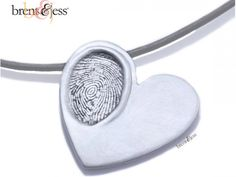 Sterling Silver Brent & Jess Custom Handmade Fingerprint Jewelry. DYI with Salt Dough - 2 cups flour, 1 cup salt, cold water. Mix until has consistency of play dough. bake at 250 for 2 hours, then cool and paint. Good recipe for thumbprint pendants