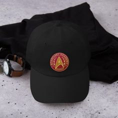 Represent your Command Division with pride by wearing this high quality Star Trek Starfleet Command Badge Embroidered Hat. Or, gift it to the leader and Star Trek fan in your life! Star Trek Starfleet Command, Star Trek Shop, Star Trek Merchandise, Embroidered Hats, Badge, Baseball Hats, Closure, Stars, Division