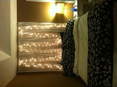 My bed... Curtains with lights above bed instead of headboard.