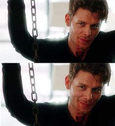 {open w/ Klaus} I was chained up because some hunter found me drinking some blood, and then tearing up the remains. Oops.. I groan as I wake up in pain, and look up at you. I smirk. You..