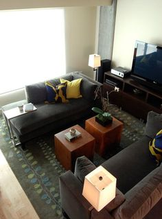 Place some furniture perpendicular to the length of the room.