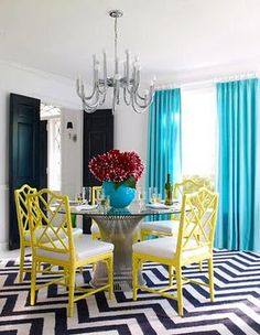 Small Chevron Stripe Obsession haha. Pop of color lemon yellow dinning chairs with teal and black & white rug