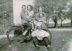 Fairmount, Indiana. c. early 1940s. My grandfather in the front. Grandmother, back right. Neighbor kid on the bike: James Dean.  My grandmother lived on the farm next to the Winslows, Dean's relatives who raised him. My great uncle Harrold was Dean's best friend growing up, and visited him in Los Angeles during the filming of Rebel Without a Cause.