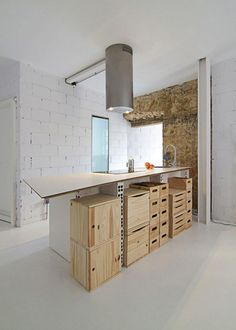 #Kitchen Storage : Remodelista - Great simple/basic warehouse style kitchen to transform with colour.