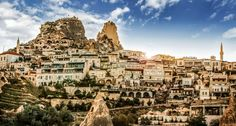 """Cappadocia, Turkey is famous for its """"fairy chimneys,"""" its unique vertical rock formations, and for the general strangeness of its landscape. But around here the region is equally famous for what's below ground level, and it's one of the most delicious two-word phrases in the language: cave hotels."""