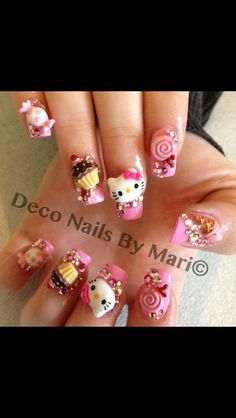 awesome. i don't know if i'm talented enough to do this or not. XD hello kitty nail art.