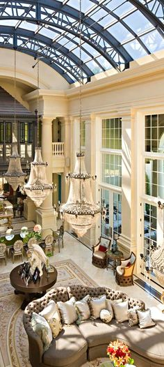 Luxury, uau! The lighting, and windows and look at those mirrored table & chairs!