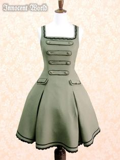 Flap Pocket Blade Jumperskirt  In olive and black  from Innocent World