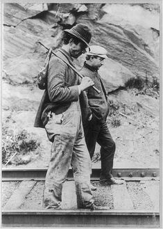Two hobos walking along railroad tracks, after being put off a train. Library of Congress.