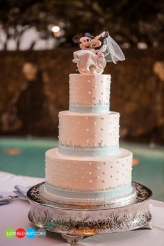 Disney Wedding Cake http://justinelement.com/blog/2012/08/mae-christian-married-hawaii-disneys-aulani/