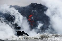 Lava flows into the Pacific Ocean southeast of Pahoa during ongoing eruptions of the Kilauea Volcano in Hawaii, U., May Terray Sylvester Sunrise Pictures, Street Pictures, Hawaii Volcano, Lava Flow, Big Island Hawaii, Pictures Of The Week, Boat Tours, Nature Photography, World