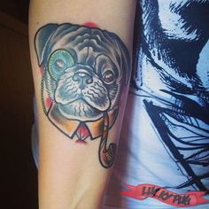 Adam at Loco-Motive Tattoo, Budapest, Hungary  This one makes me consider a pug for my black dog.