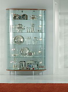 showcases wood curved | Glass display cabinet, Showcases with wooden structure, Glass showcase ...