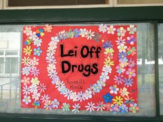 Beach Theme for the classroom. Red Ribbon Week: Lei Off Drugs. Students decorate flowers and glue them to the poster.