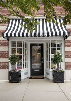 love. brick and black & white striped awning. liz caan via design darling.: