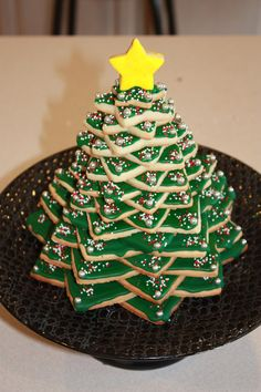 I used the Wilton cookie tree cutter kit to cut all of the star shapes to make the tree.