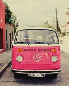 Travel in style in this retro pink Volkswagen van!