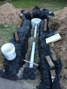 Picture of French Drain with Dry Well maybe this would fix the water problem in the backyard