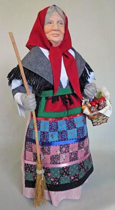 La Befana in long skirt and cape
