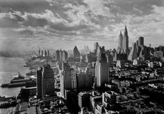 River House, 52nd St. and E. River, New York City. Cloud study, noon, looking south from 27th floor. Photographed by Samuel H. Gottscho, December 15, 1931 on 5x7 b&w film.
