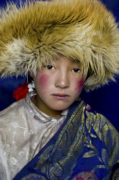 """""""Photo by // Nomad girl wearing fur hat in the Damda region, Kham, Tibet. From the plains of Mongolia, to the sands of Africa, and the…"""" We Are The World, People Around The World, Beautiful World, Beautiful People, Amazing People, Alison Wright, Nam June Paik, National Geographic Travel, Steve Mccurry"""