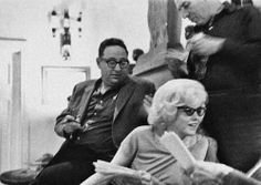 Marilyn with Carl Sandberg and friends at the home of producer Henry Weinstein, 1961.