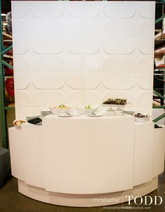 Stepped Reception Counter with a white chrysalis screen makes for unique serving. (Delicious food by Zov's catering!)