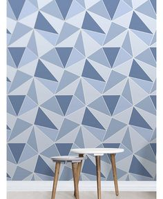 This Apex Geometric Wallpaper in tones of blue features a contemporary geometric pattern with a metallic outline. Free UK delivery available