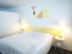 A DIY bedroom makeover - tangram wall art and a painted headboard