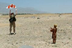 27 June Major Richard Sneddon of the Royal Regiment from Valcartier, Quebec, commandant of the Canadian civil-military co-operation team, helps an Afghan boy get his kite into the air. Canadian Soldiers, Canadian Army, The Kite Runner, Photo Exhibit, Canada Day, Modern Warfare, Armed Forces, Afghanistan, The Neighbourhood