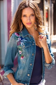 We love handmade details. And our denim jacket is blooming with embroidered flowers to add colorful visual interest to our sensuously shaped button-front jacket with side seam and button flap chest pockets.