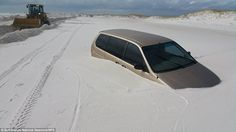 Snow chance: Florida has not been hit by a wintry flurry, but huge sand drifts have engulfed cars and blocked coastal roads