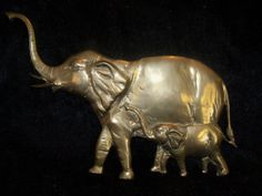 Vintage brass elephant with baby wall hanging by KimCycleDesigns, $36.00