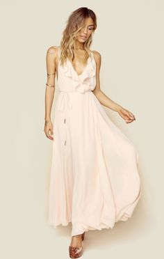 "Kendall + Kylie bring you this soft and sweet maxi dress. The Ruffle Wrapped Maxi Dress features a gathered wrap front with tie closure, ruffled neckline trim, and full length skirt. Lined.  ImportedDry Clean OnlyPoly BlendFit Guide:Model is 5ft 7 inches; Bust: 32"", Waist: 24"", Hips: 34""Model is wearing a size XSRelaxed FitShoes Featured Not Available For Purchase"